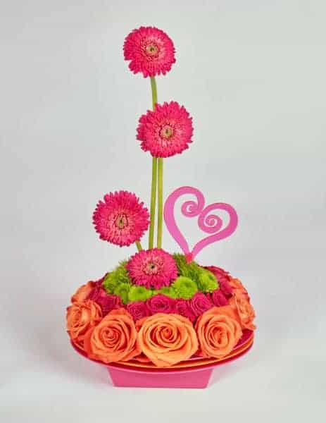 Oval And Orange Valentine Floral Centerpiece