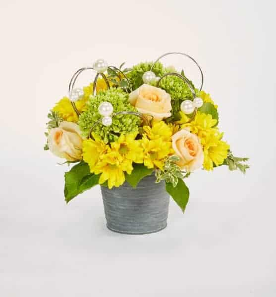 Tin Pot And Peach Floral Arrangement